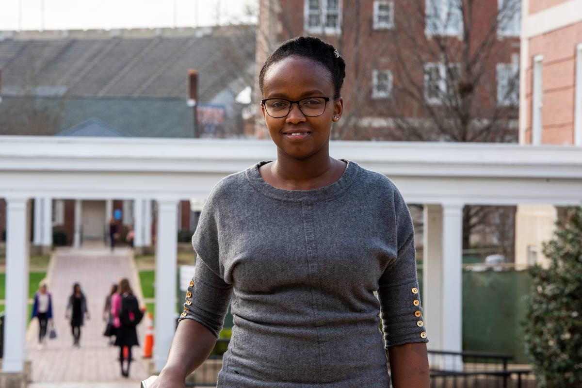 Photo of Karen Ngugi standing in front of Cater Hall.